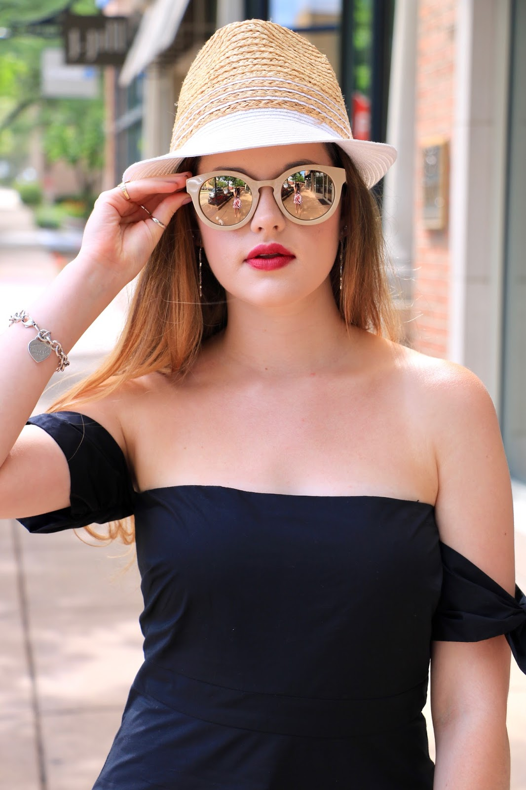 Fashion blogger Kathleen Harper of Kat's Fashion Fix showing how to wear a fedora