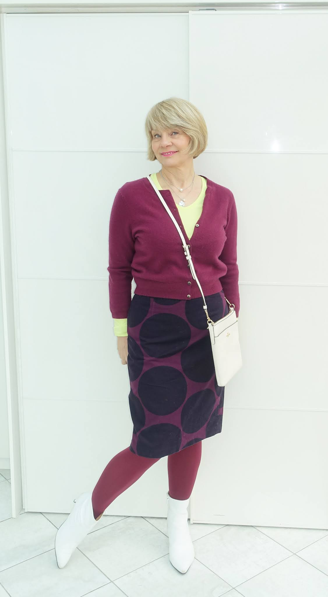 How to style a patterned knee length skirt:  this colourway on over-50s blogger Gail Hanlon is burgundy and navy with a splash of acid yellow