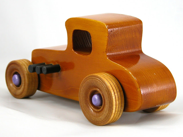Left Rear -  Wooden Toy Car - Hot Rod Freaky Ford - 27 Coupe - Pine - Amber Shellac - Metallic Purple Hubs