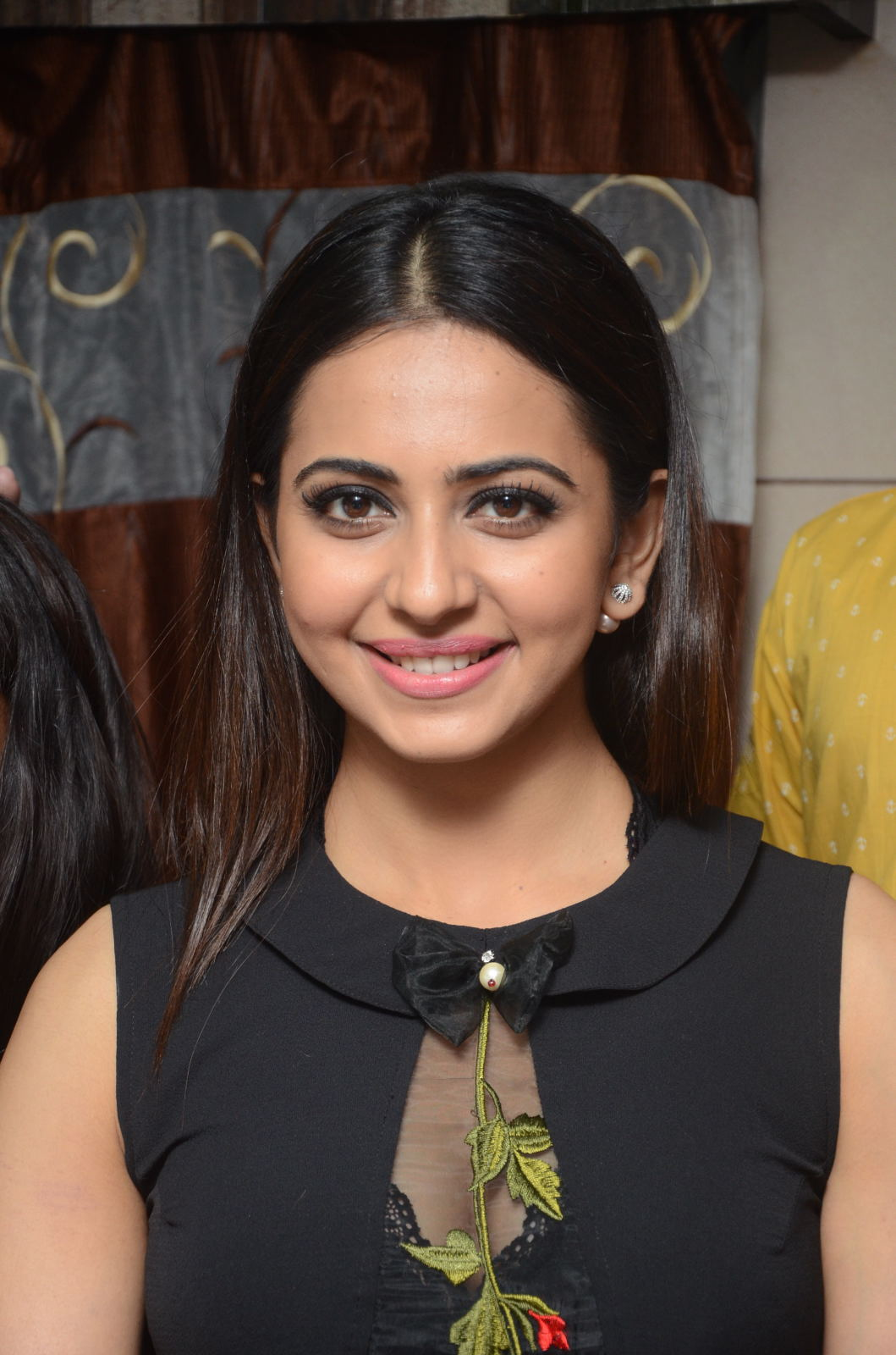 Rakul Preet Stills At Sahara Cafe Launch In Black Dress