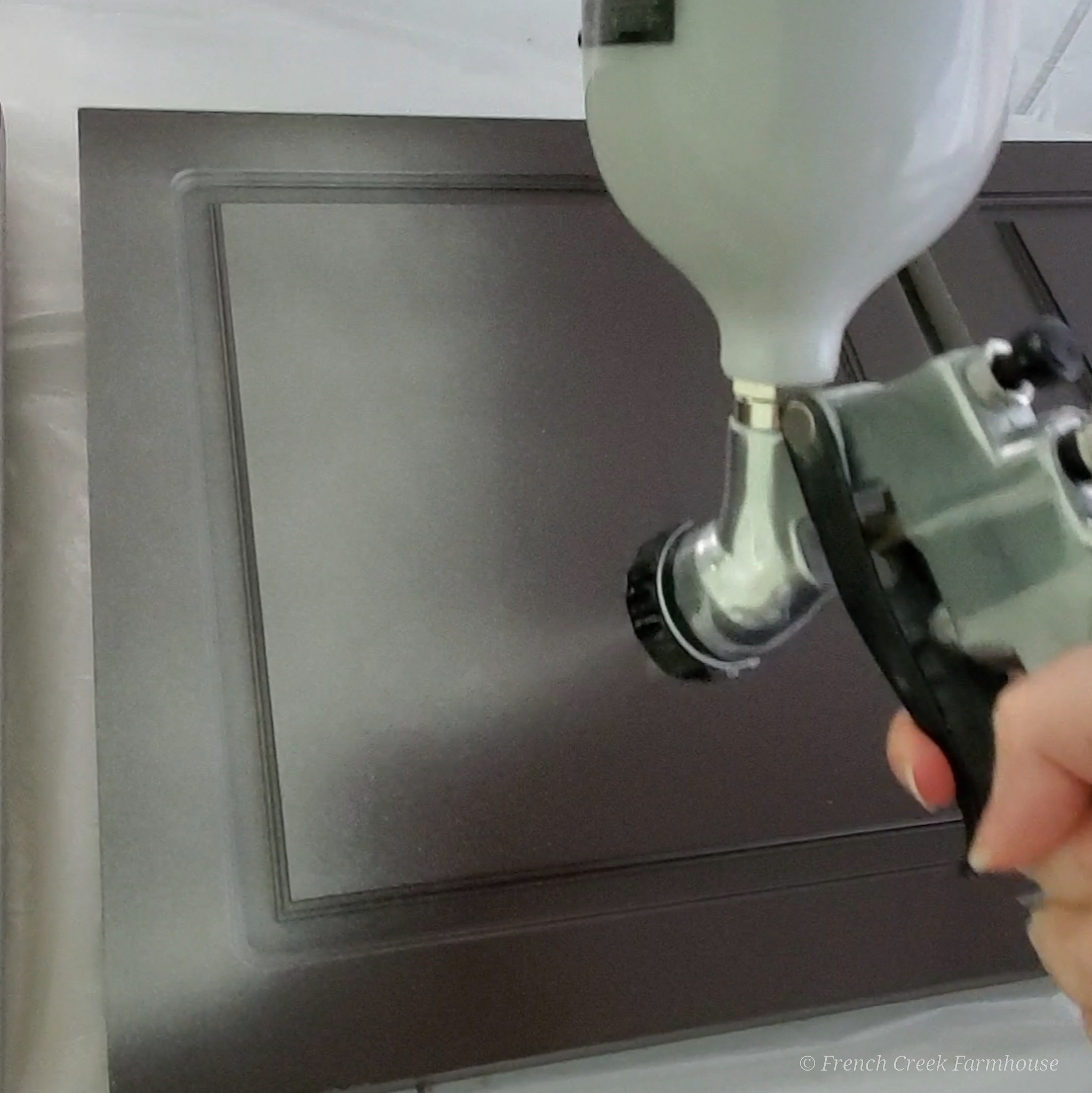 Using an HVLP gravity fed spray gun makes a smooth and professional finish