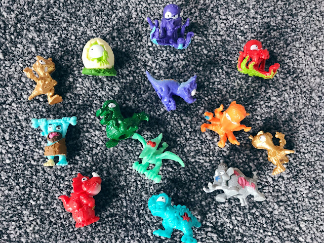 Little dinos and creatures from the eggs laid out