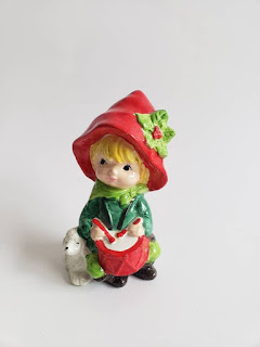 Little boy in red hat with drum and dog ceramic figurine