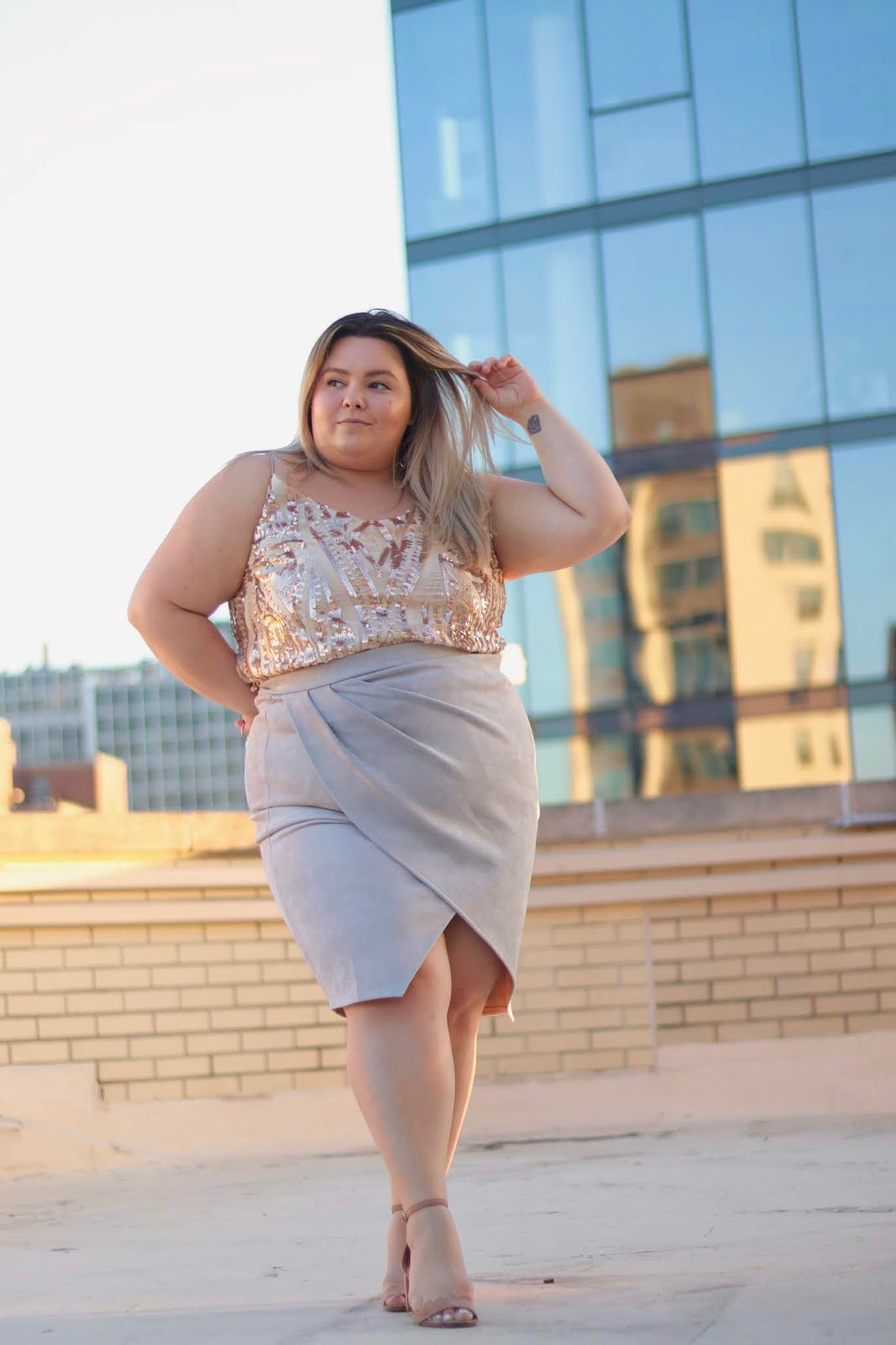 Chicago Plus Size Petite Fashion Blogger, influencer, YouTuber, and model Natalie Craig, of Natalie in the City, reviews Marée Pour Tai's pleated wrap suede midi skirts.