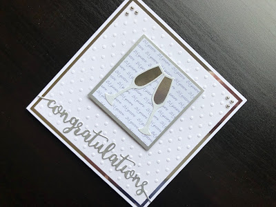 Hand made silver wedding anniversary card with embossed background and champagne glass embellishments