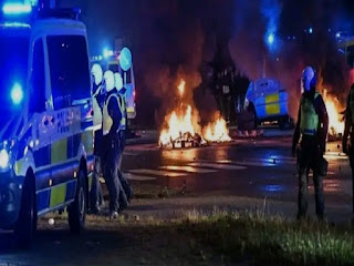 Riots erupt after burning religious texts in Sweden, 15 detained