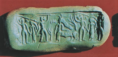 Impression of Kalibangan Cylinder Seal K-65 shows a goddess wearing a horned head-dress and having the hind part of a tiger.
