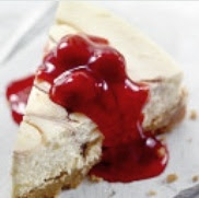 Wadge of cherry almond cake served with Cherry compote
