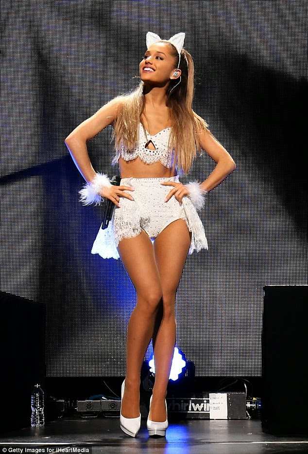 Ariana Grande very leggy display in cat outfit on stage photo 1