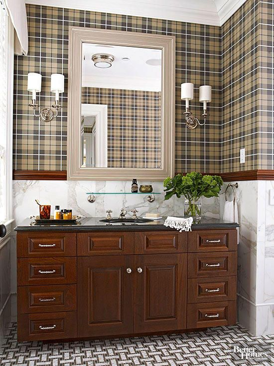 plaid wall paper and dark wood chair rail
