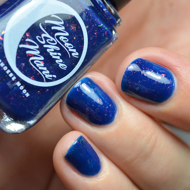blue crelly nail polish with chameleon flakies