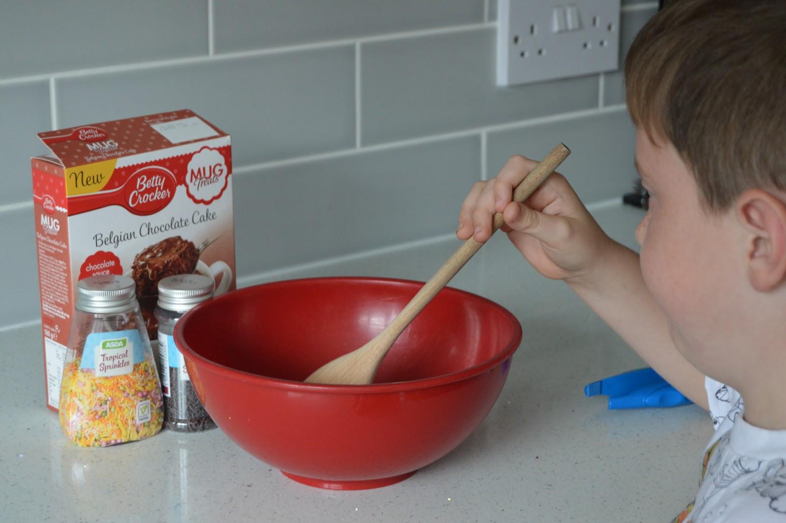 Boy baking a cake
