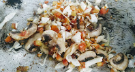 Sauteing mushroom with chicken pieces for hot and sour chicken soup recipe
