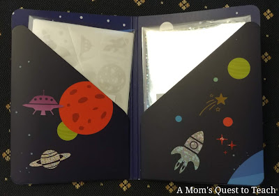 small folder with foil and 'stickers' from Artistic Patch Cosmos; space design on folder