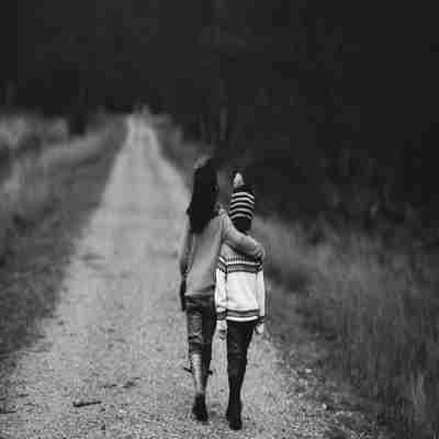 two little friends walking on a road