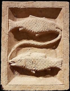 Roman era relief carving of Pisces symbol