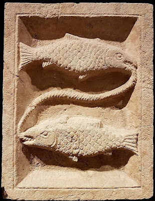 Roman era relief carving of Pisces symbol