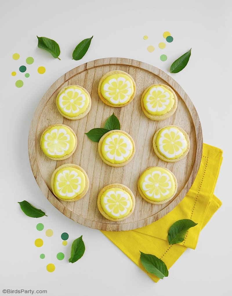 Lemon Decorated Sugar Cookies - easy recipe for a lemon shaped sweet treat that's perfect for a lemon themed wedding, birthday or summer party! by BirdsParty.com @birdsparty #cookies #lemoncookies #decoratedcookies #lmeonsugarcookies #sugar cookies #lemondecoratedcookies #lemonrecipes #lemonparty #lemonpartyfood