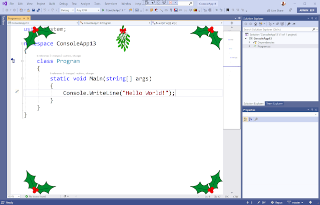 Visual Studio editor with holly in each corner and mistletoe at the top