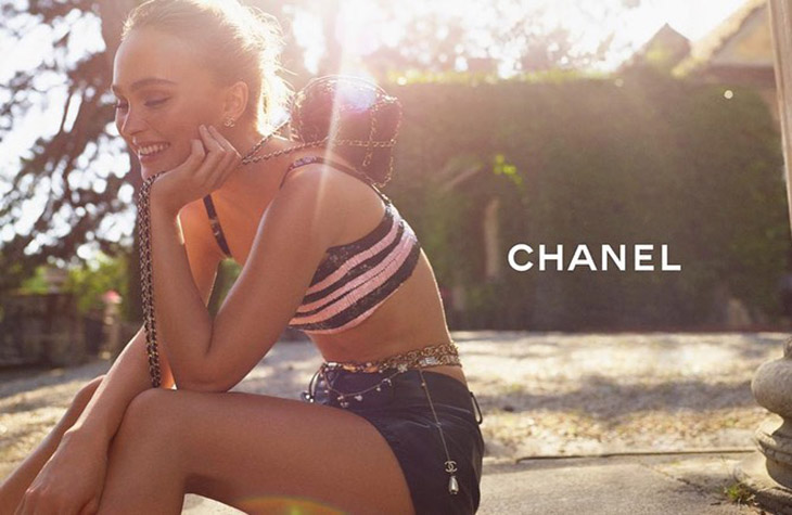 Actress Lily-Rose Depp flashes a smile in Chanel cruise 2021 campaign.