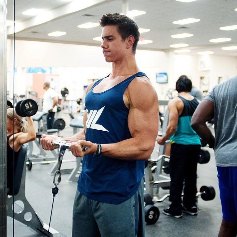 young-fit-sexy-gym-dude-huge-swole-muscle-biceps-working-out-hard