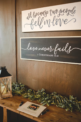 wedding welcome table with rustic decor