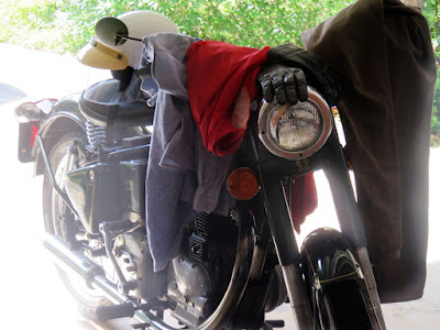 Royal Enfield draped with riding clothes.