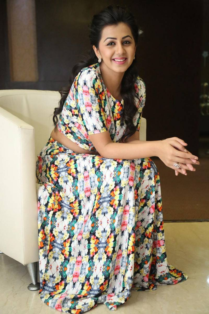 Nikki Galrani Stills Latest Photoshoot In White Dress
