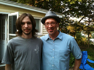 Bassist Aaron Nebbia and his former teacher, Earl MacDonald pose for a photo together.