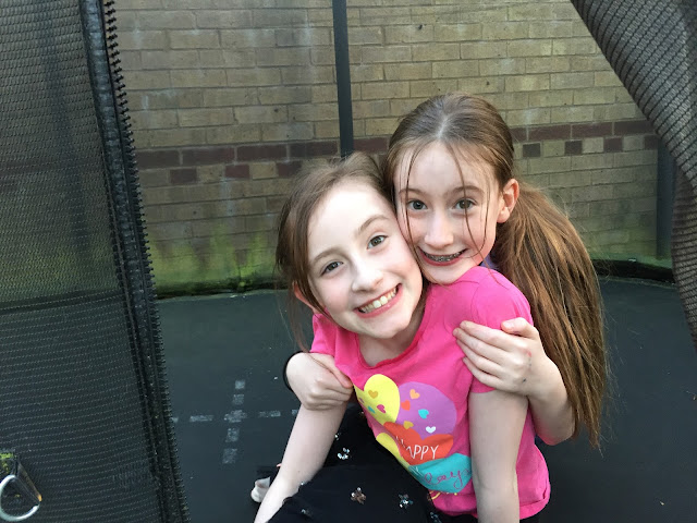 Stephs two girls happy on trampoline