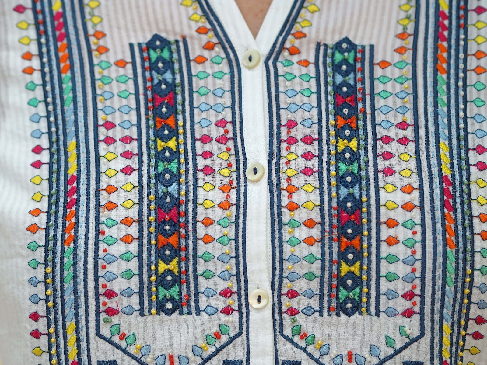 East shirt with multi-colored embroidery