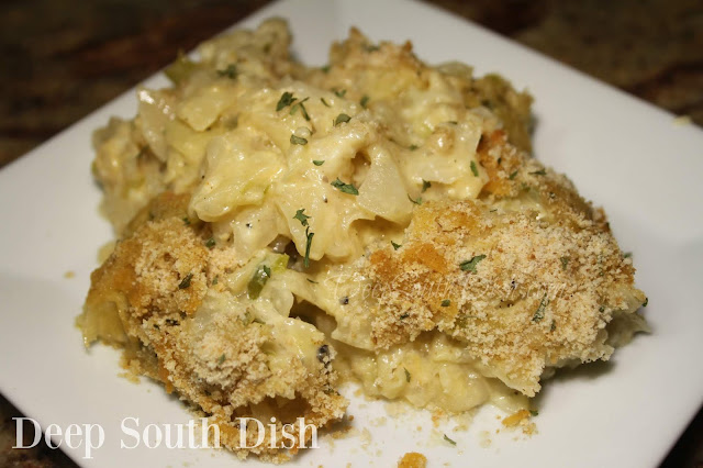 Cajun Cabbage au Gratin, also known in this area as Choux Glorieux, or Glorious Cabbage, is a casserole of cooked, chopped cabbage, made with The Trinity, milk moistened bread, cheese and finished with a bread crumb and cheese topping.