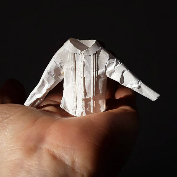 tiny white button-up shirt made of paper