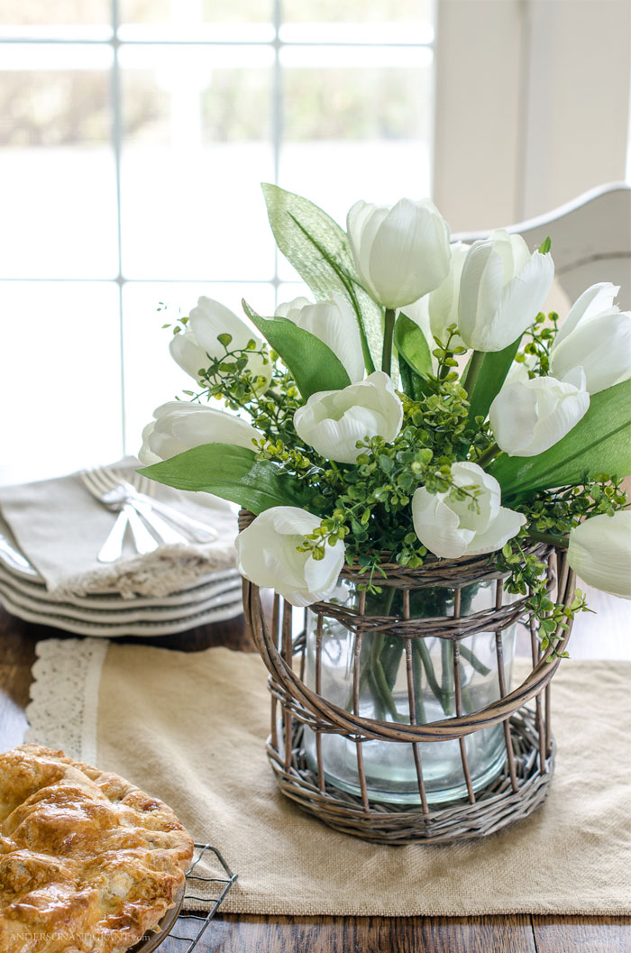 Learn the secrets behind creating a realistic flower arrangement for spring out of fake flowers from the craft store. #DIY #flowerarranging #flowers #andersonandgrant