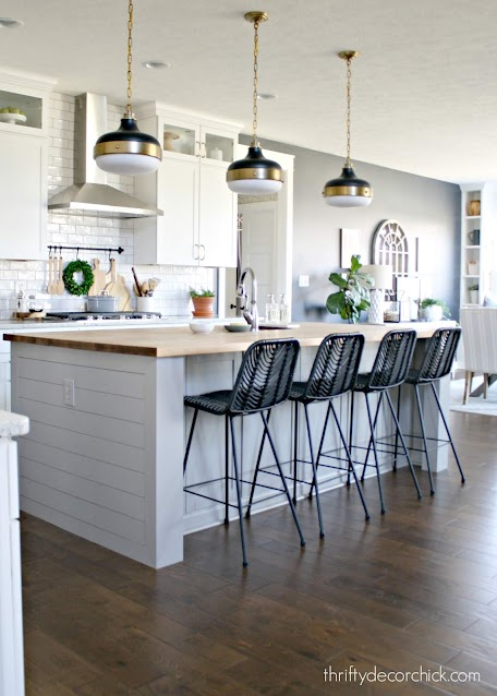 light gray island black chairs
