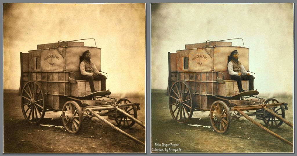 Marcus Sparling seated on Roger Fenton's photographic van, Crimea, 1855. color colorization colorized