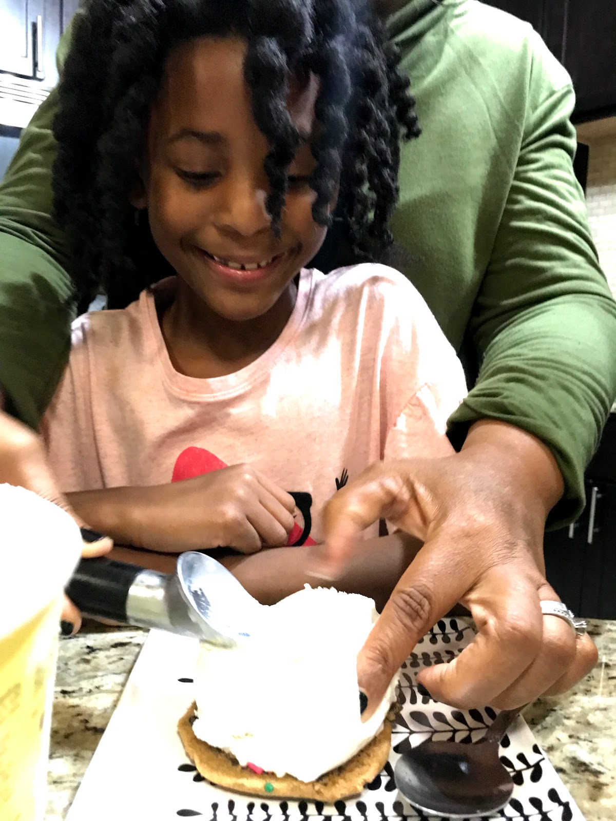 Image: Tangie Bell and Daughter Moriah making cookies to share on blog . The joyful list