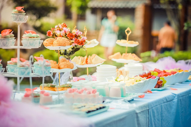 A buffet table of colorful pastries and fruits.