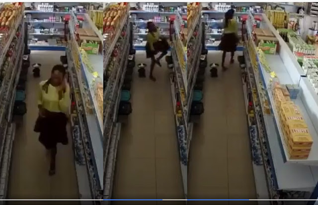 Beautiful Nigeria Lady Caught Stealing From A Supermarket (Video)
