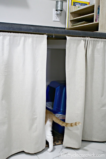 Cute way to hide litter boxes