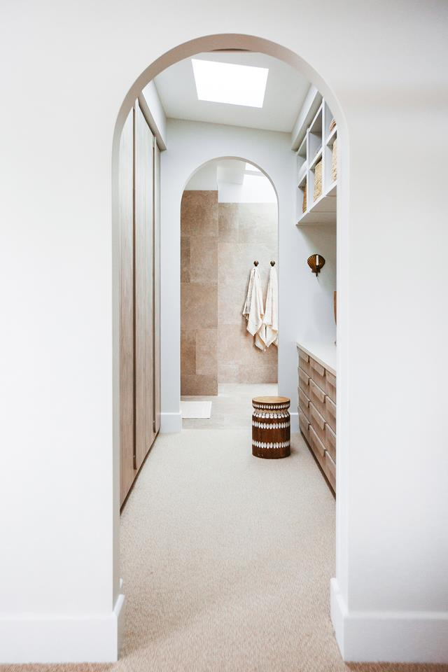Arched doorways to the ensuite closet and bath