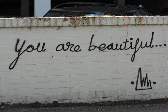 """You Are Beautiful"" Spraypainted on a brick wall"