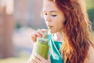 Lady Drinking Green Juice