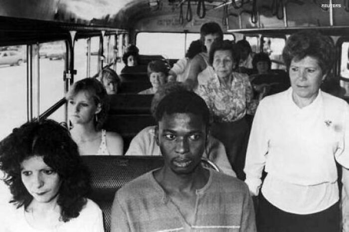 #16 A Man Rides A Bus In Durban, Meant For White Passengers Only, In Resistance To South Africa's Apartheid Policies, 1986