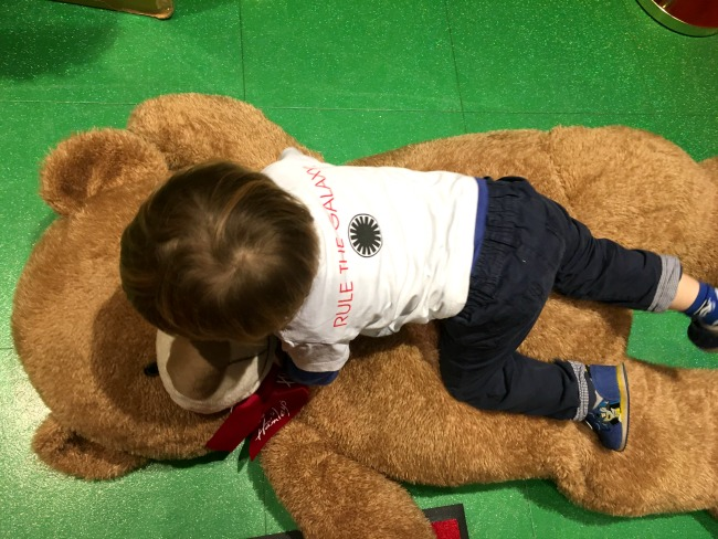 toddler-playing-with-bear