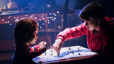 Andy, played by Gabriel Bateman, and Chuck, voiced by Mark Hamill, play a game together in the new horror film Child's Play