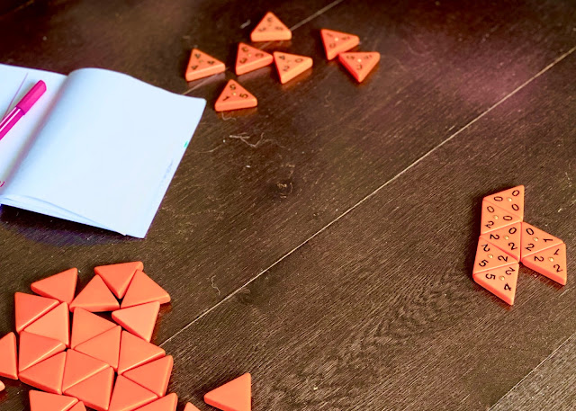 orange triangle shaped pieces with a number in each corner are Trominos.
