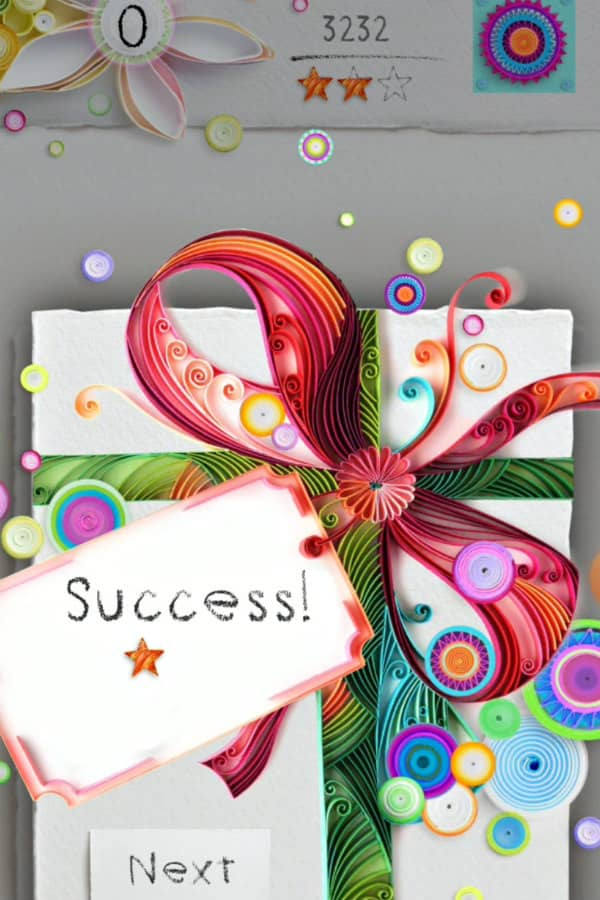mobile game app features colorful on edge paper art in shape of bow with success sign