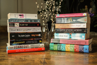 October book haul featuring a stack of books