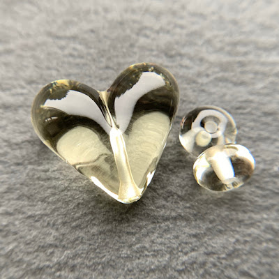 Handmade lampwork glass heart bead by Laura Sparling made with CiM Candlelight
